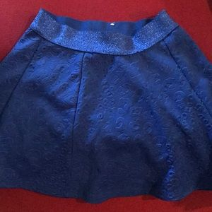Justice blue skirt embossed with cheetah print